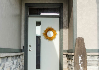 Schneider Custom Homes doorstep with fall decorations
