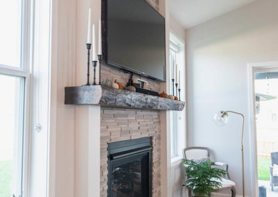 Schneider Custom Homes brick fireplace and TV
